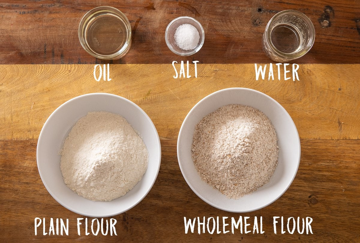 Ingredients for homemade chapati on a wooden table