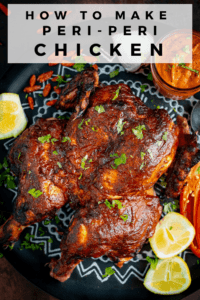 Roasted Peri Peri chicken on a dark tray