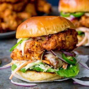 Crispy chicken burger on a brioche bun with lettuce.