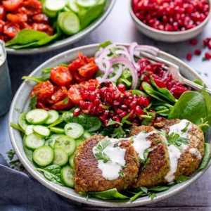 Salad bowl with falafel and feta dressing in a grey bowl