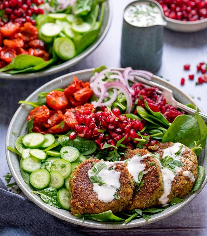 Salad bowl with falafel and feta dressing - little jug of dressing in the background