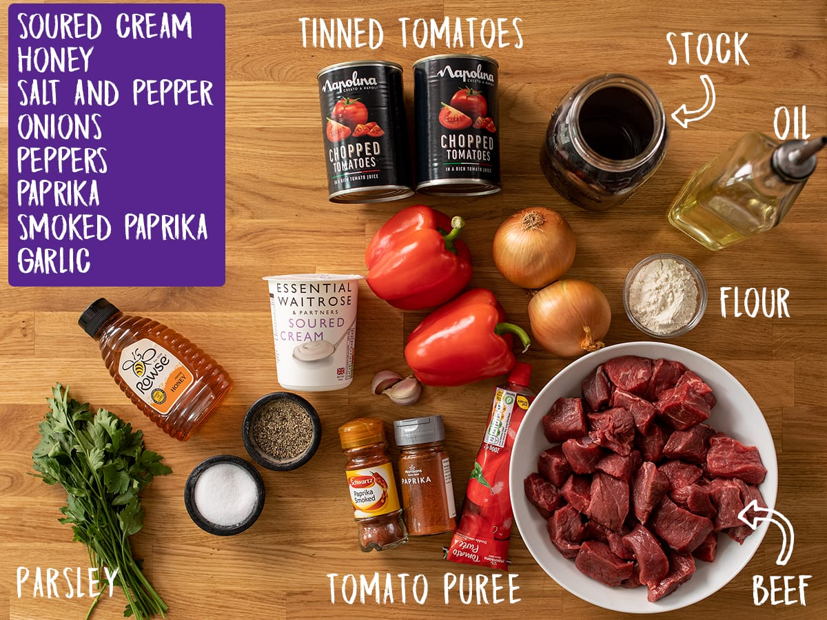 Ingredients for Beef Goulash on a wooden table