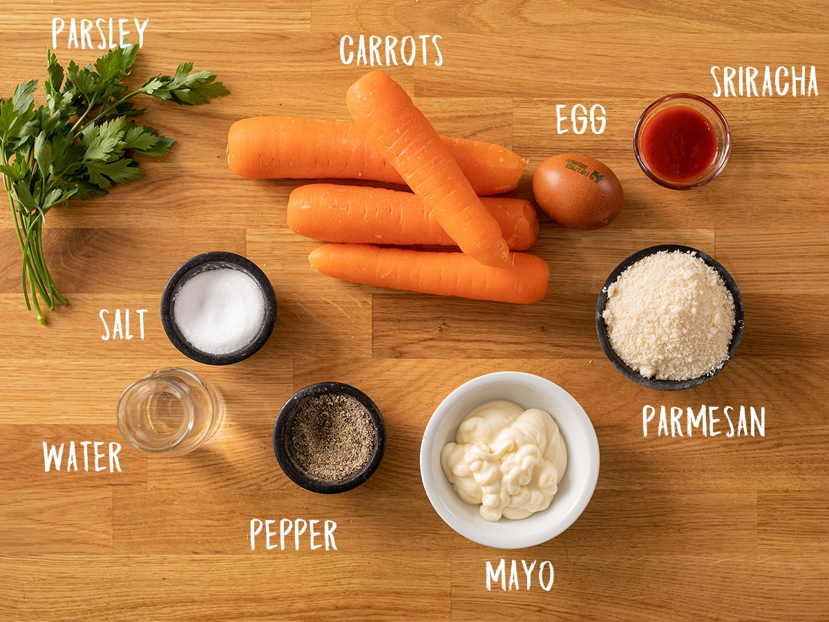 Ingredients for carrot fries on a wooden table