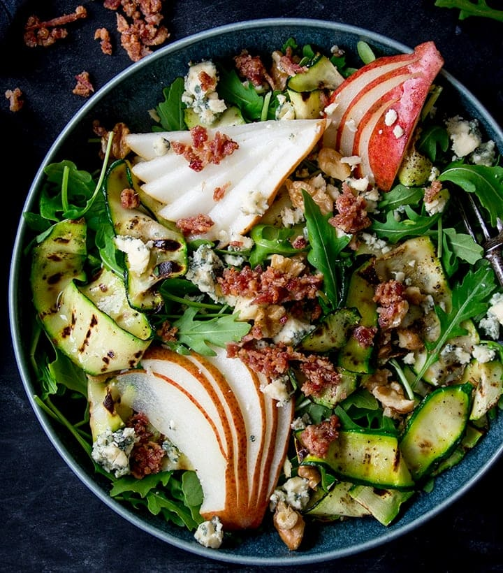 Grilled Zucchini, Stilton and Pear Salad on a dark background
