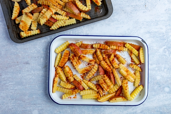Crinkle potato fries on a baking tray ready to be cooked