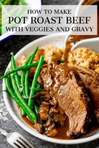 Gravy being poured onto plate of sliced beef and vegetables. Text overlay on the image