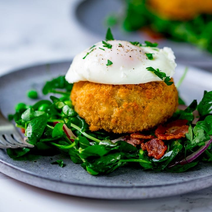 pea and bacon salad topped with a fish cake and poached egg