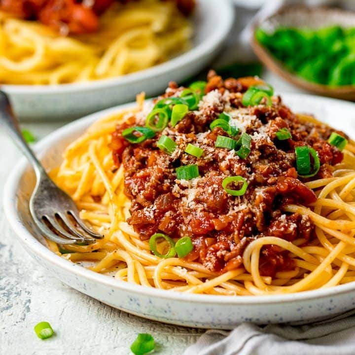 Plate of spaghetti bolognese on a light background