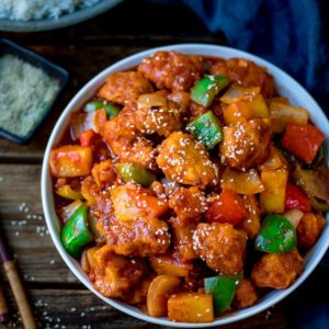 Sweet and sour chicken in a white bowl