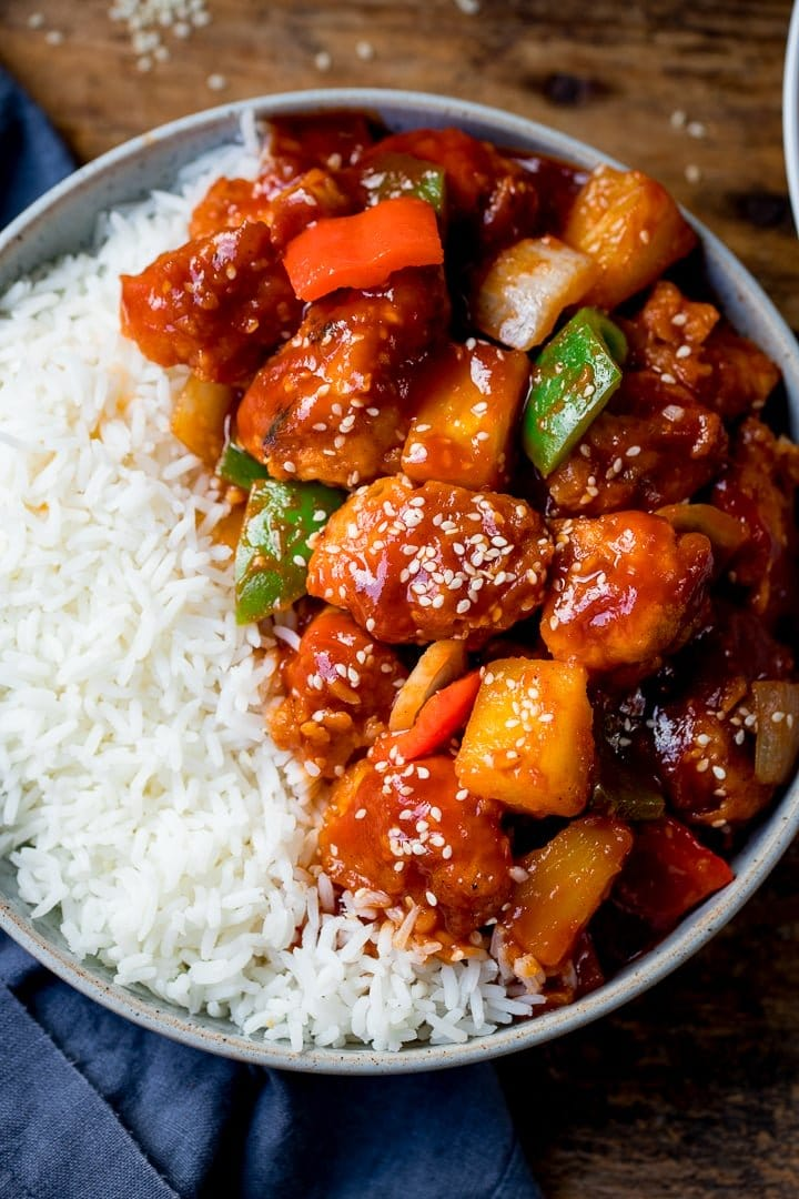 Sweet and sour chicken in a bowl with rice