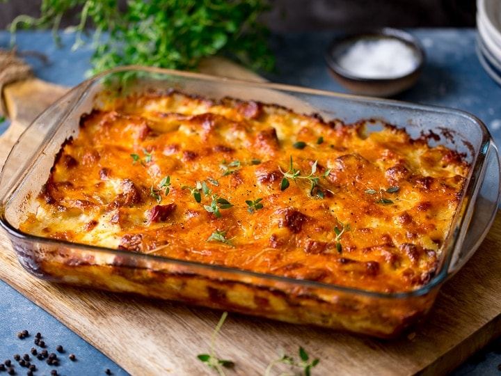 wide image of Scalloped potatoes with ham in a dish