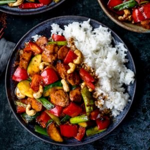 Square image of kung pao chicken with rice