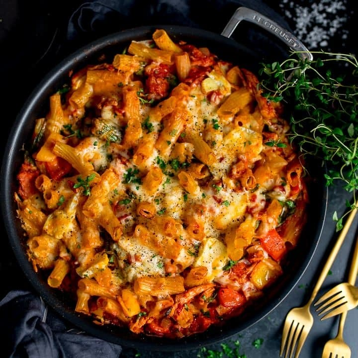 Overhead image of leftover turkey, ham and cheese pasta bake in a black pan