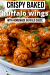 Buffalo wings piled up on a white plate