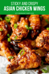 Sticky Asian Chicken Wings piled up with spring onions on top