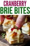 Cranberry Brie bites on a wooden board