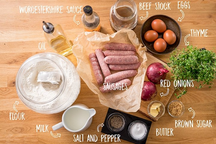 Ingredients for toad in the hole on a wooden table