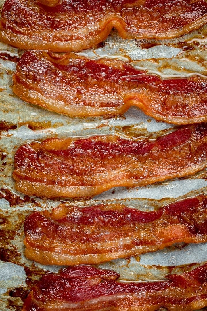 Overhead image of cooked bacon on a tray