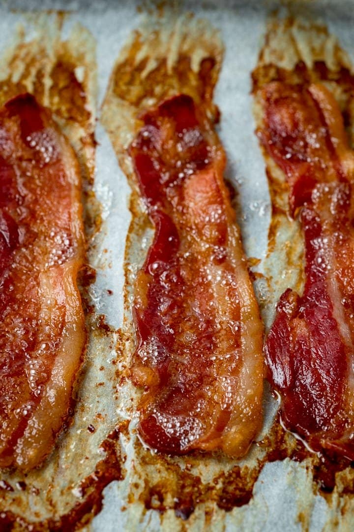 Close up of cooked bacon on a tray