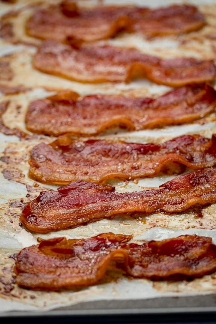 cooked bacon on a tray lined with parchment