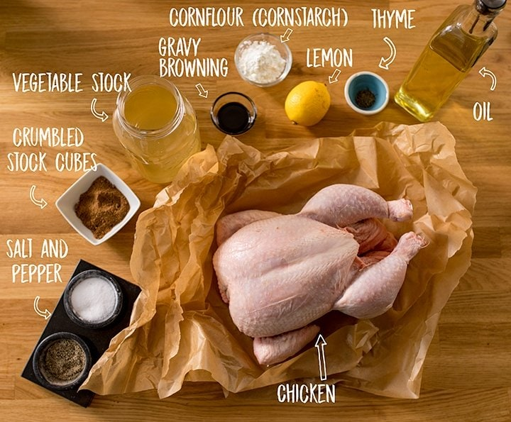 Ingredients for roast chicken and gravy on a wooden table