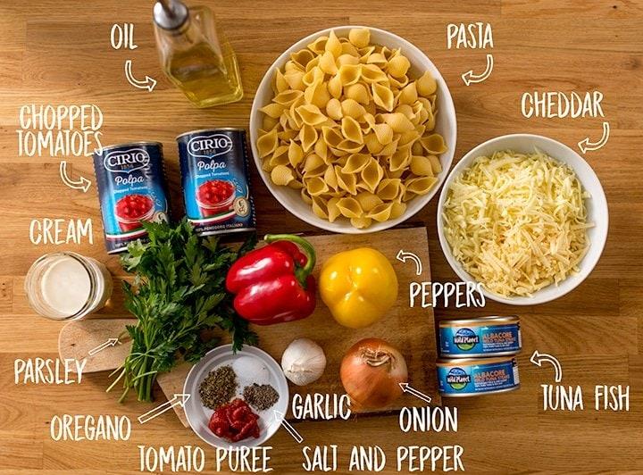 Ingreidients for Tuna Tomato Pasta Bake on a wooden table