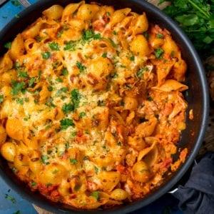 tuna pasta bake in a pan on a dark background