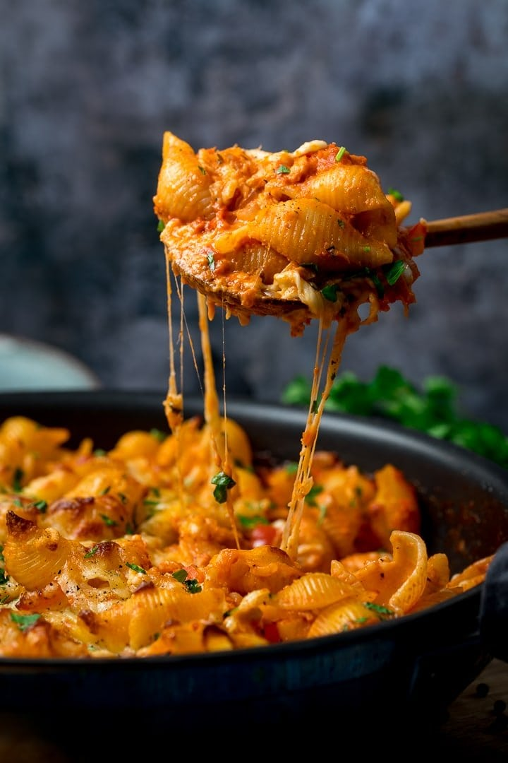 Tuna pasta bake being lifted out of the dish with a spoon