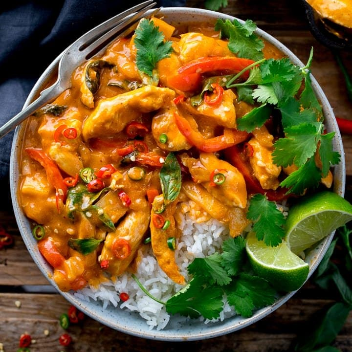 Overhead image of Thai red chicken curry with rice in a bowl
