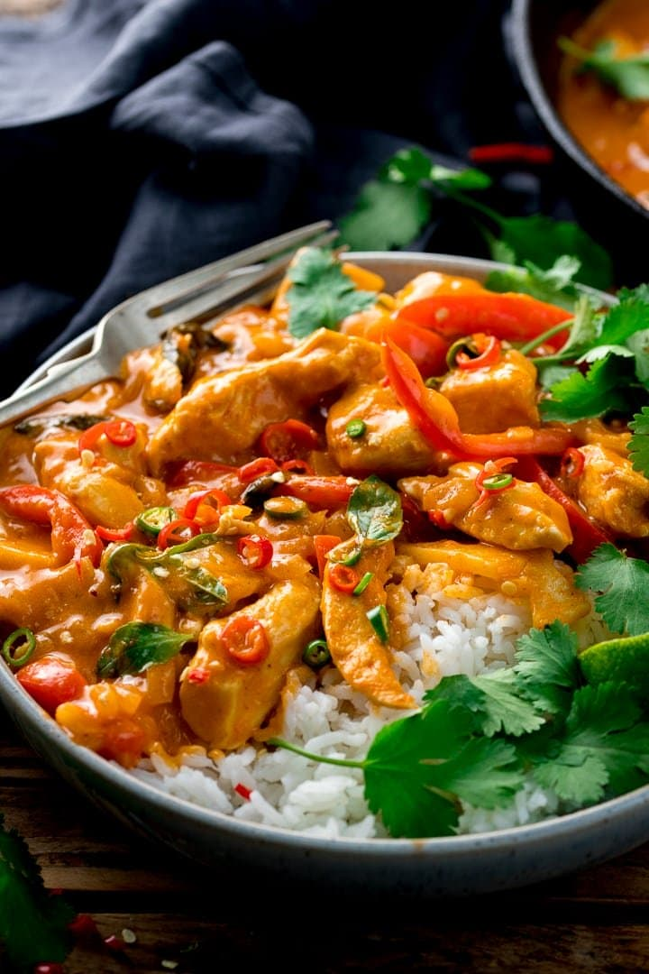 Thai red chicken curry with rice in a bowl