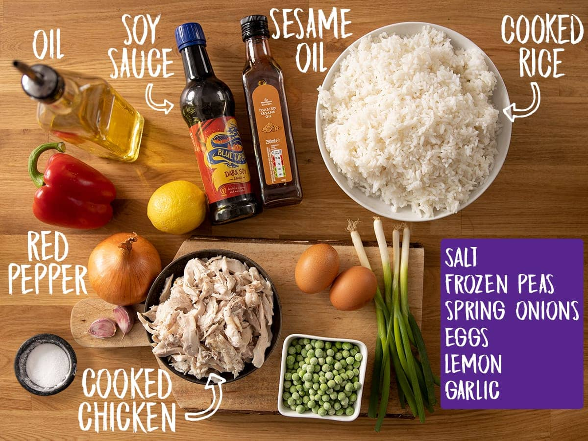 Ingredients for Chicken Fried Rice on a wooden table