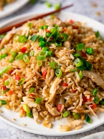 Chicken Fried Rice on a white plate topped with spring onions