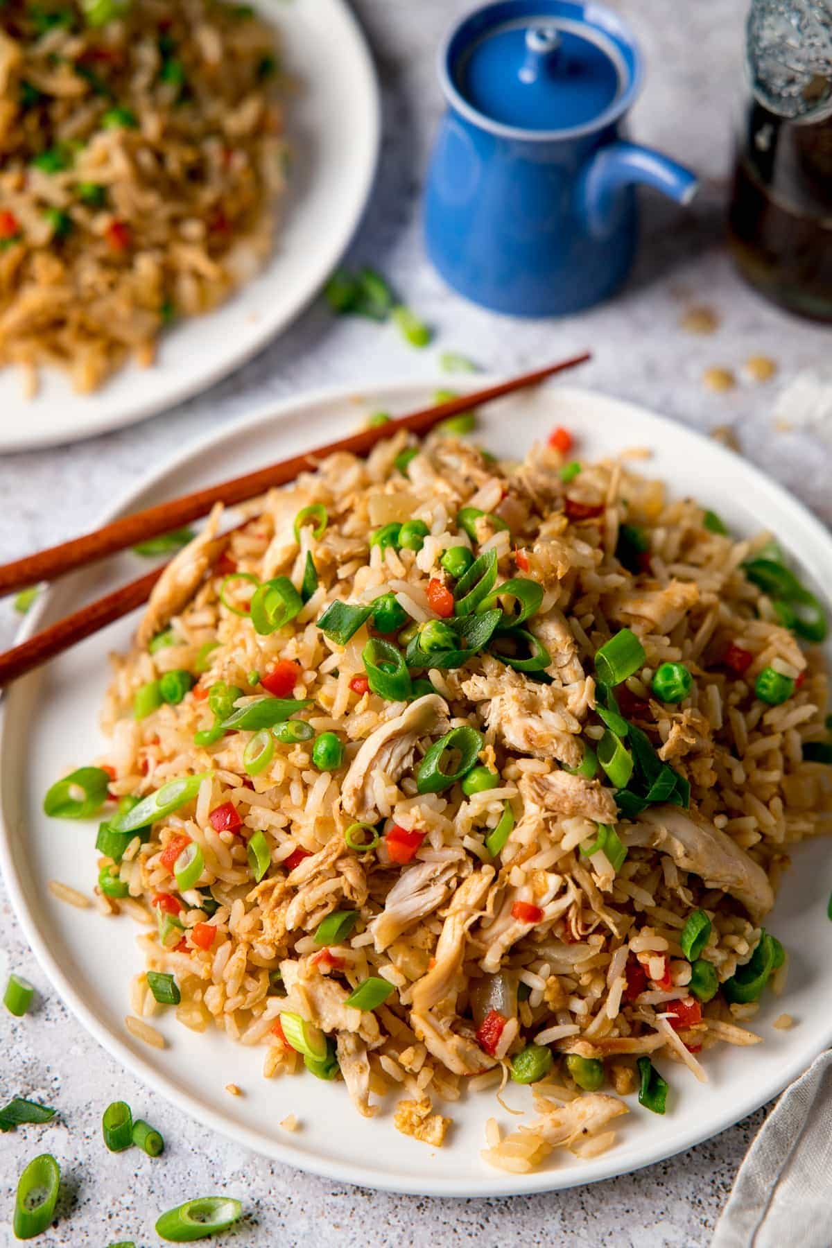 Chicken Fried Rice on a white plate with chopsticks