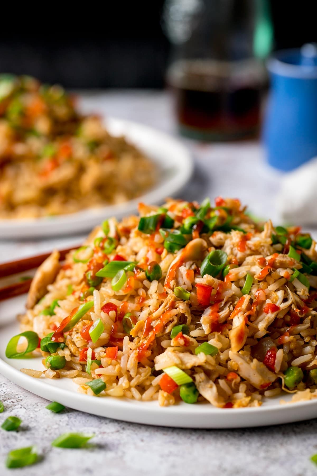 Chicken Fried Rice on a plate with chilli sauce on top