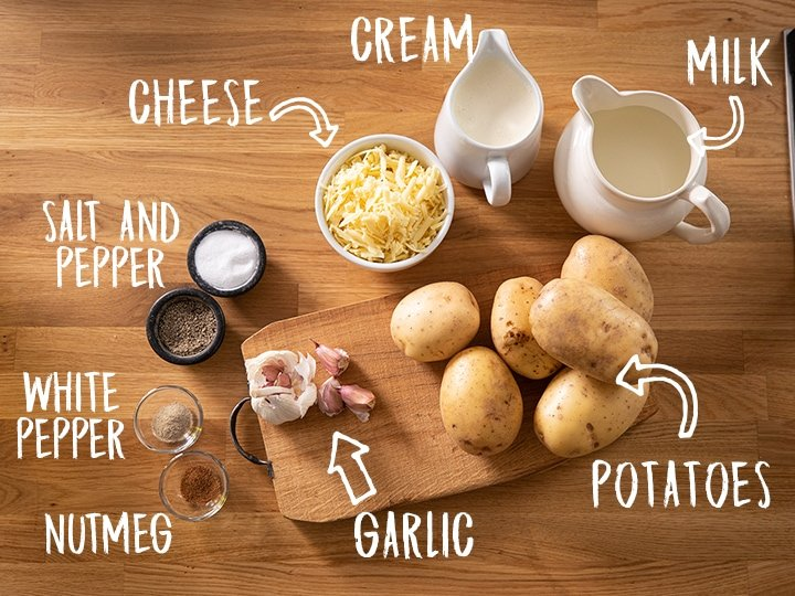 Ingredients for Dauphinoise potatoes on a wooden table