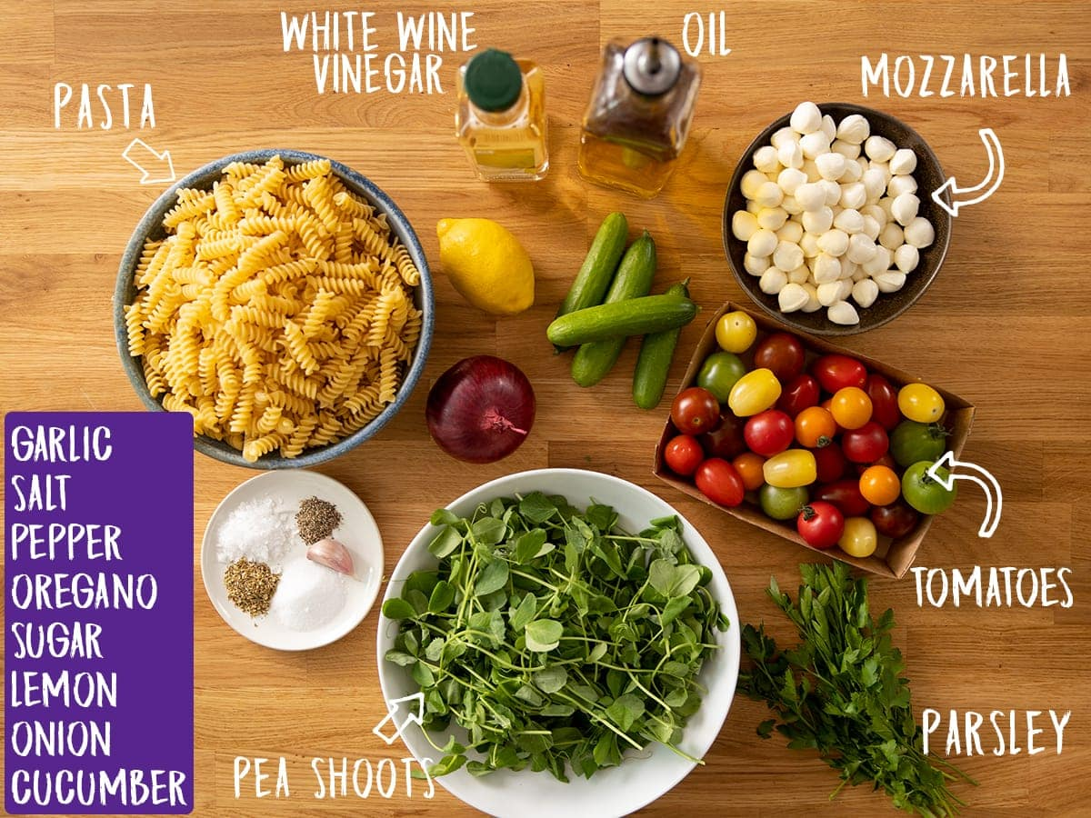 Ingredients for pasta salad on a wooden table