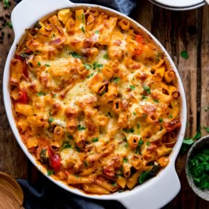 square image of vegetable pasta bake in a white dish