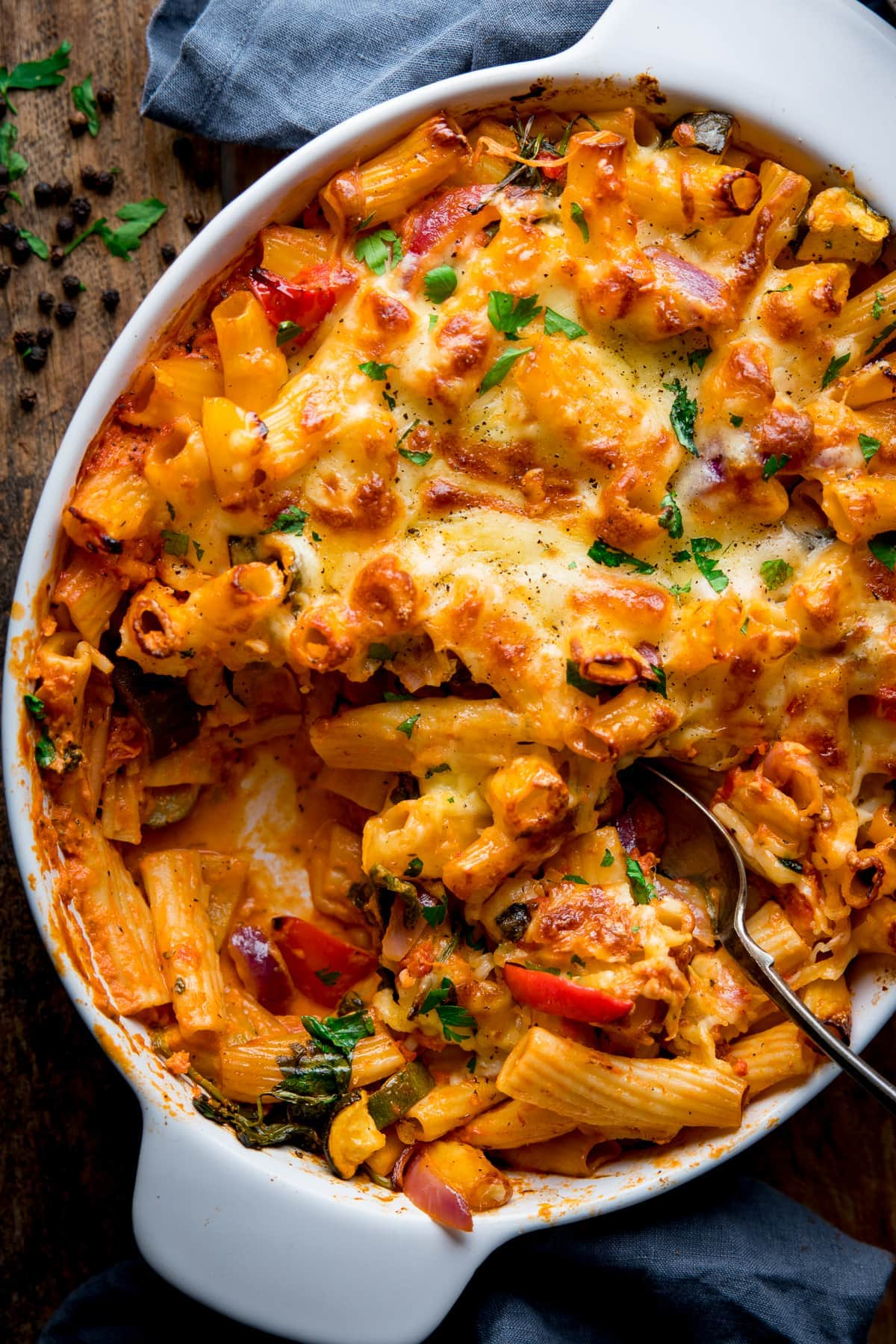 Overhead image of vegetable pasta bake with a spoonful taken out
