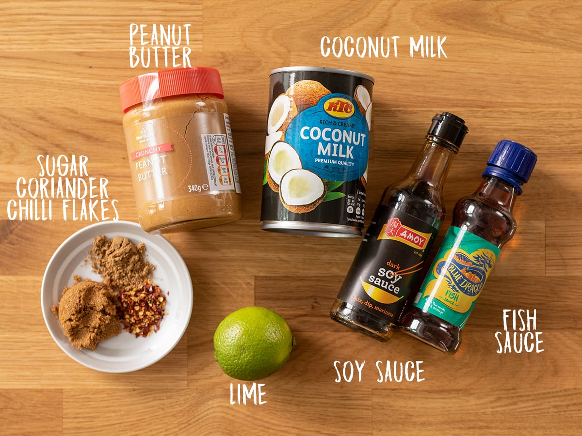 Ingredients for satay sauce in a wooden table