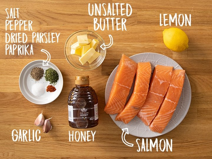 Ingredients for honey garlic baked salmon on a wooden table