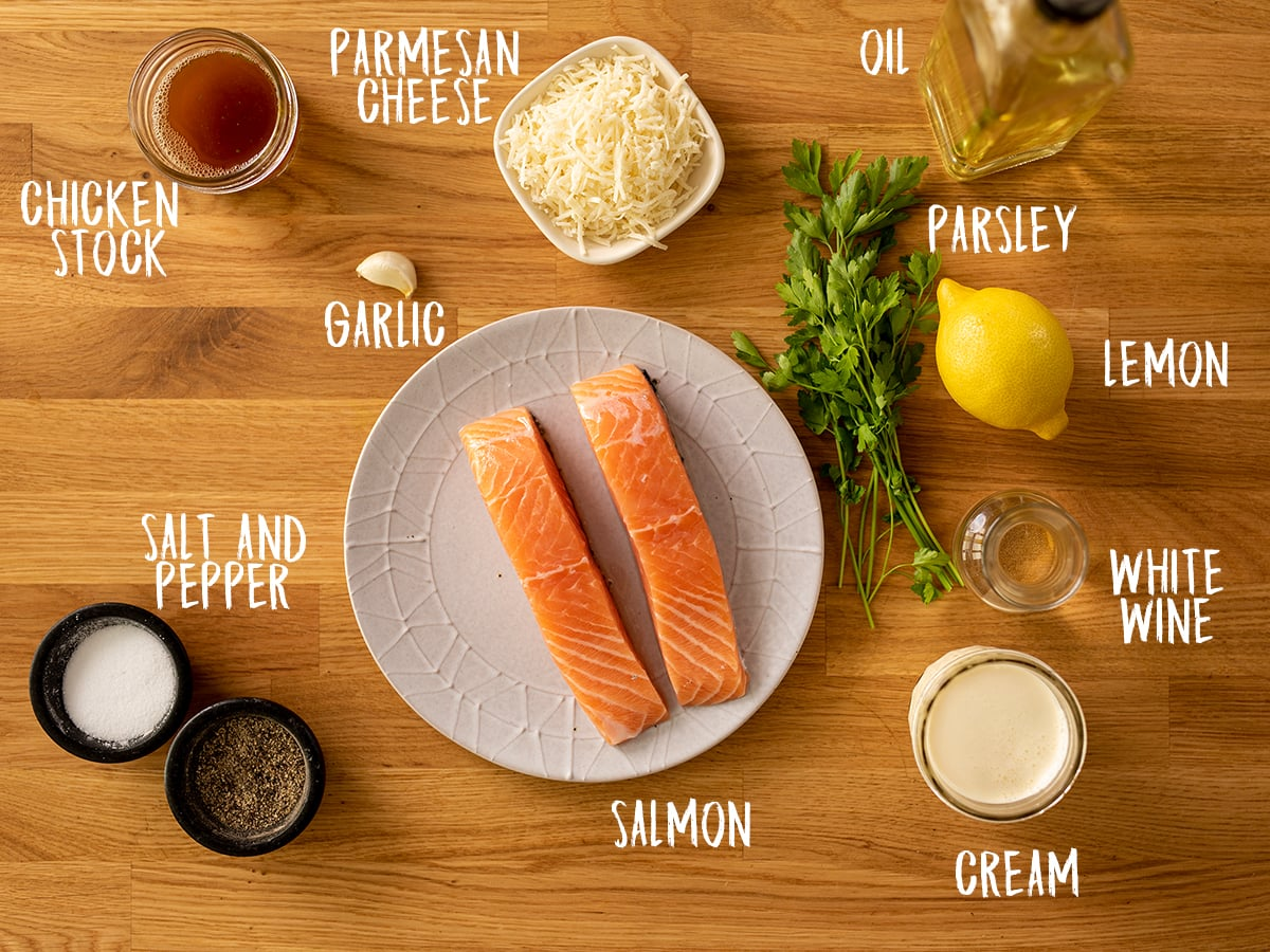 Ingredients for salmon with creamy white wine sauce on a wooden table