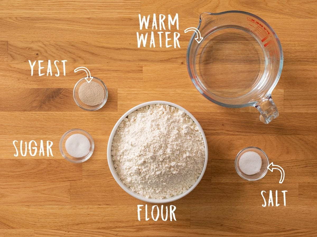Ingredients for making Artisan Bread on a wooden table
