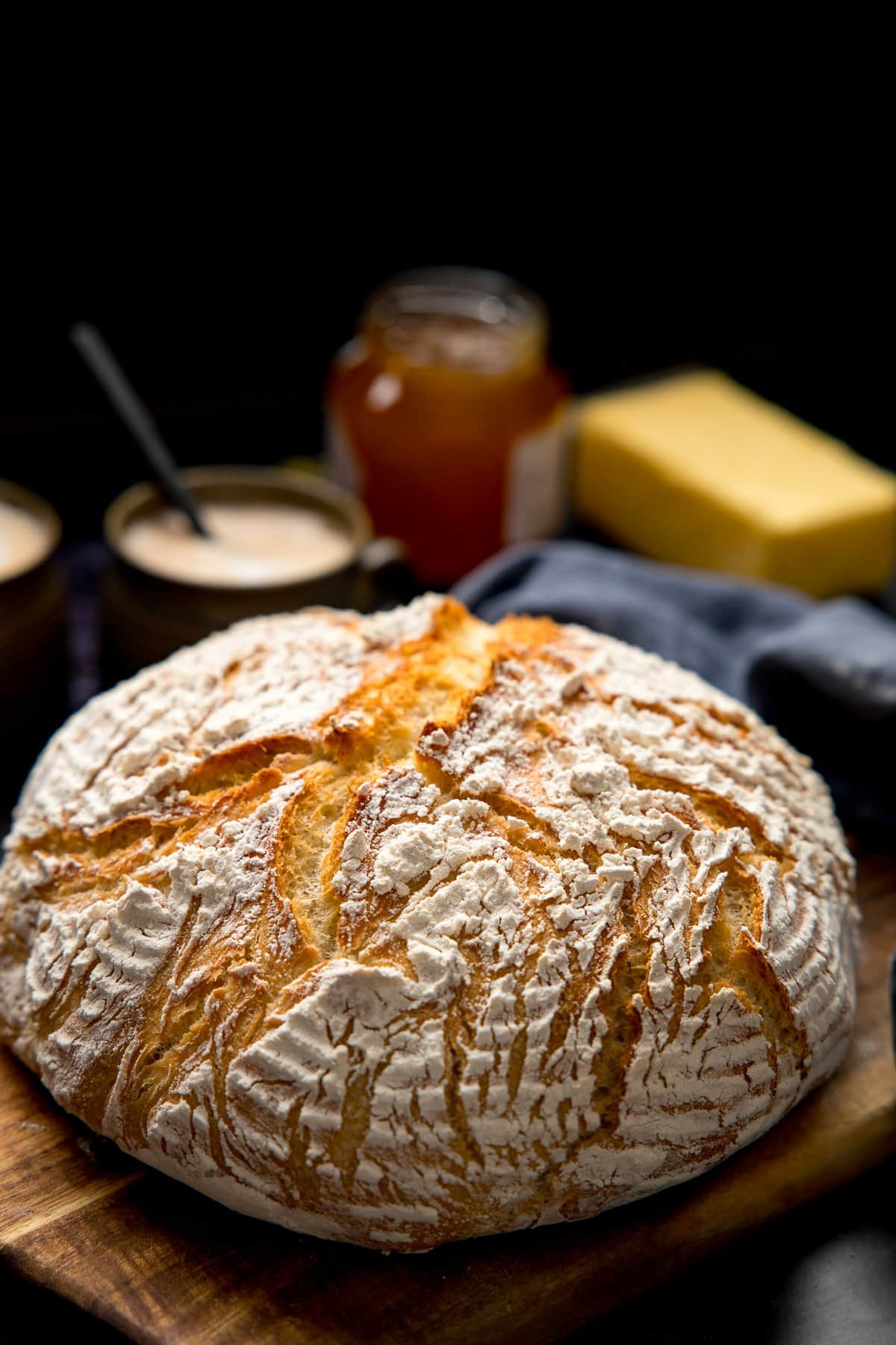 Artisan bread on a wooden board against a dark background