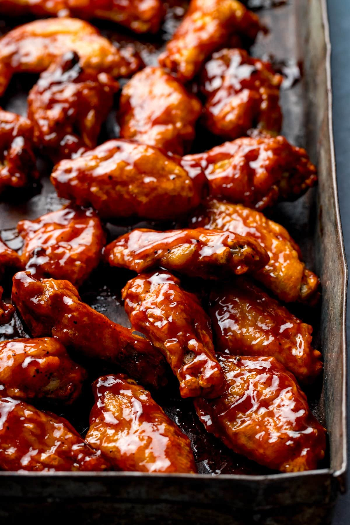 BBQ chicken wings on a baking tray