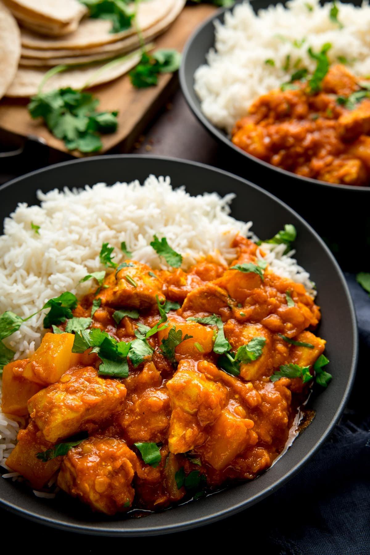 chicken dhansak and rice in a dark bowl