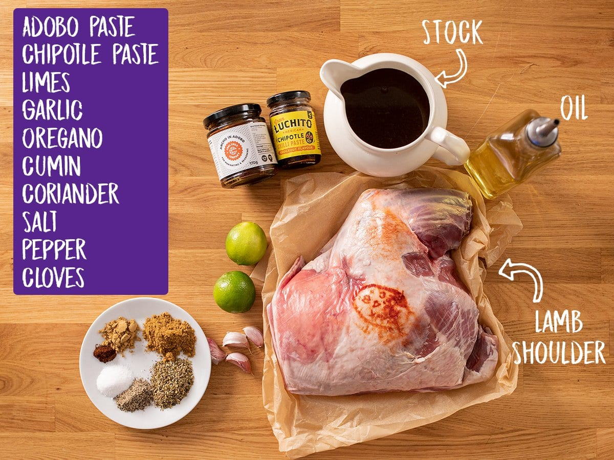 Ingredients for lamb barbacoa on a wooden table