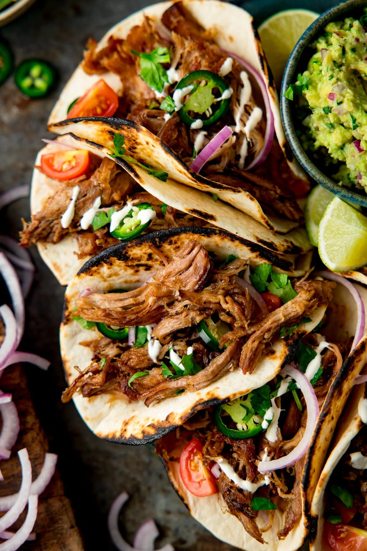 Lamb Barbacoa Carnitas Tacos piled up on a plate