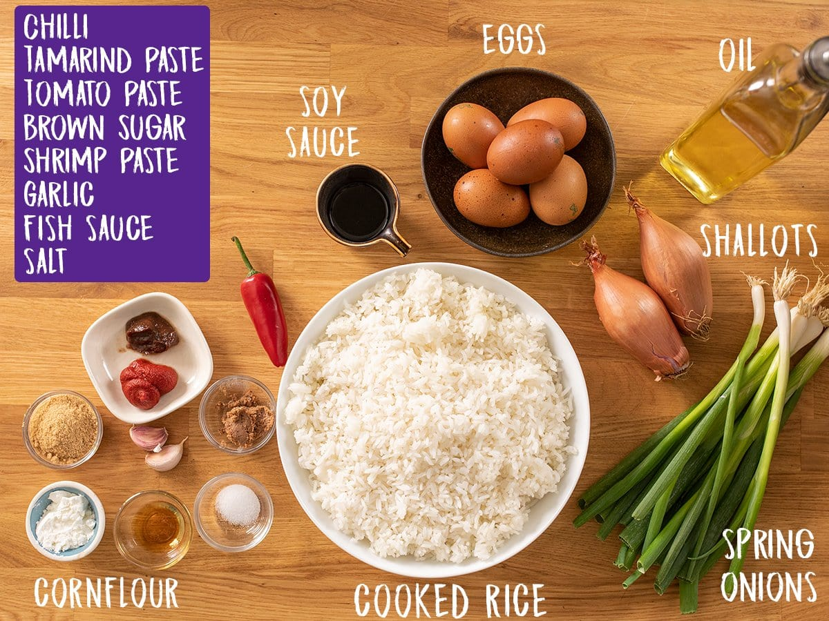 Ingredients for nasi goreng on a wooden table
