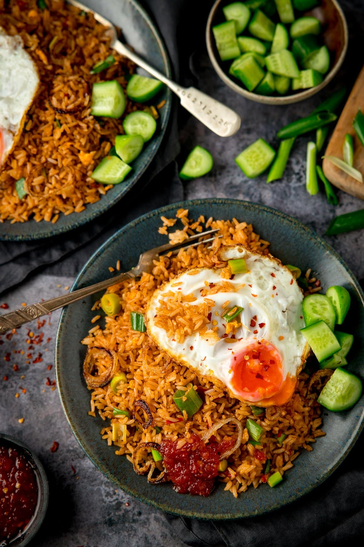 Overhead image of nasi goreng rice on a plate, topped with a fried egg