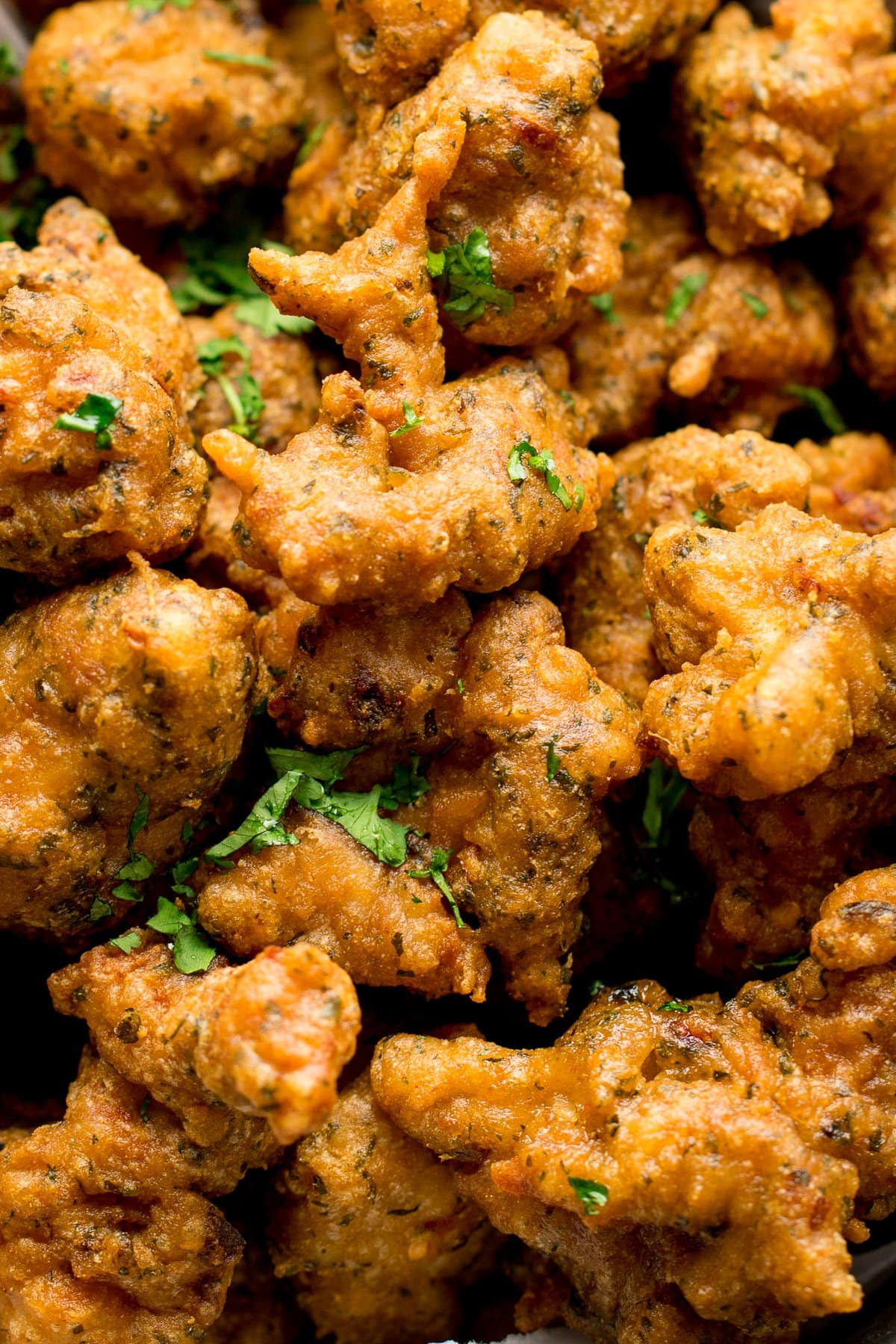 Close up of chicken pakoras scattered with coriander